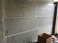 Shop fitting grid wall with brackets and hangers