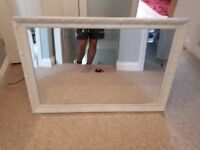Wall mirror with off white surround