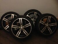 Four BMW alloy wheels need a good jet washing or respray other than that good condition.