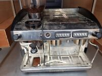 Coffee machine, wooden table , stainless steel table