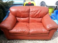 Terracotta coloured leather two seater sofa