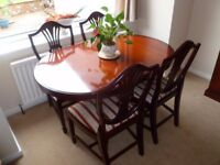 STAG EXTENDING DINING TABLE AND FOUR CHAIRS.
