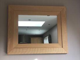 Large, light wood mirror