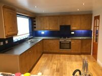 Complete fitted kitchen with integrated oven and fridge utility unit and breakfast bar...