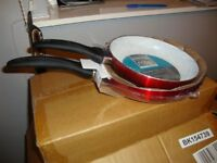 red ceramic frying pan set of 2, 20cm and 24cm. boxed and unopened.