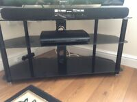 A set of black glass TV stand and coffee