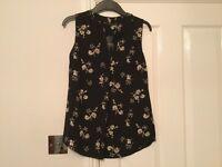 Ladies black floral pattern vest style blouse top Brand New size 8