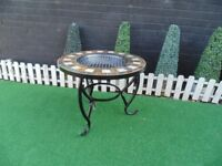 CAST IRON AND MOSAIC FIRE PIT VERY SOLID AND IT'S IN EXCELLENT CONDITION 70/55 cm £45