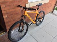 "Carrera vengeance orange 21"" mountain bike"