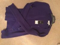 Size 12 purple cardigan. Never worn, still has price ticket attached.