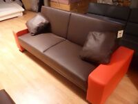 Red And brown faux leather sofa bed