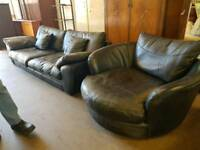 Black leather two seater sofa and cuddle chair suite