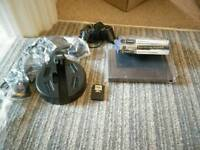 Slimline PlayStation 2 with accessories and games