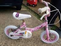 Children's pink bike