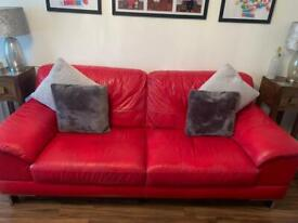 DFS red leather three seater sofa and cuddle chair