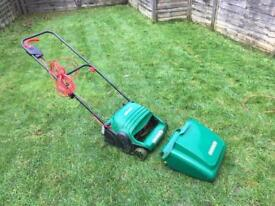 Electric lawn mower with catcher