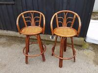 Two spinning wicker bar stools