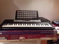 Yamaha PSR - E203 home keyboard