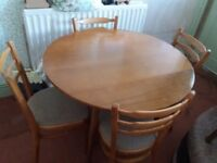 Round table and 4 matching chairs. Drop leaf