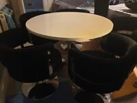 Velvet chairs and gloss table