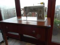 SINGER FAMOUS 'TOUCH AND SEW' DELUXE AND EASY TO USE SEWING MACHINE WITH CABINET AND MORE!