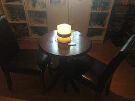2 x leather chairs and round bar table