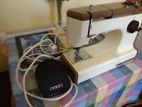 Sewing Machine for sale. Good condition electric sewing machine with carrying case.