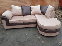 Comfy Brand New corner sofa.beige fabric and brown trim.never used.delivery available