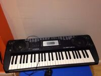 SK560 Electronic Keyboard & metal stand