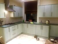 kitchen with gas cooker. With hood integrated dish washer Under cupboard Fridge. integrated units