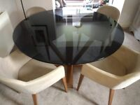 Calligaris dining table and four chairs