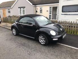 Black Volkswagen Beetle Convertable