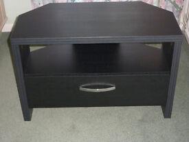 Black wood corner TV unit with a large drawer