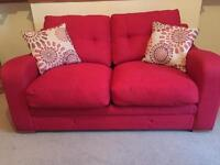 Double sofa bed with matching chair and cushions