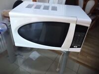 Hardly used White microwave for sale