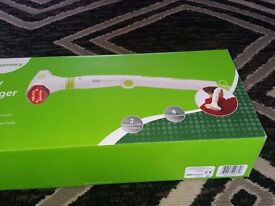 Back massager brand new still boxed . Great for soothing aches and pains with heat function .