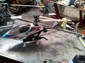 Two rc helicopters align 700 no canopy and rapter 50 complete. receivers will be removed before sale