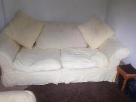Sofa, armchair and foot stall.