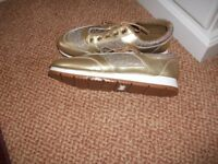 Brand new gilt trainer-type shoes