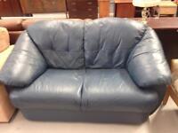 2 seater sofa. Dark blue leather. Ok condition. £25