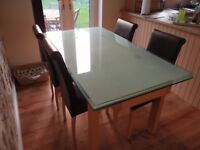 GLASS EXTENDING DINING TABLE WITH FOUR CHAIRS