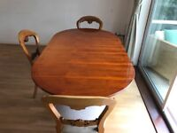 Beautiful reproduction French polished dining table with 4 chairs