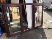 Upvc window, rosewood on white