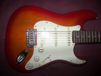 Fender Squier Standard Stratocaster Electric Guitar / Cherry Sunburst.
