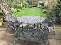 Victorian style wrought iron garden patio table and chairs furniture set.