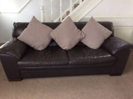 Real leather black/brown sofas. 3+2 and footstool