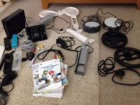 Nintendo Wii bundle, inc 2 x nunchuck, various games and accessories - see photo