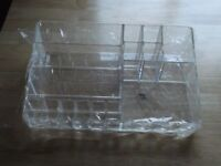 desk tidy(brand new) in clear perspex sizes h 8cm...d 21cm...l 33cm,still in original packaging