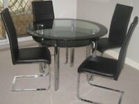 Modern design glass and chrome dining table and chairs
