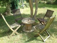 4 wooden garden chairs and wooden cable reel table